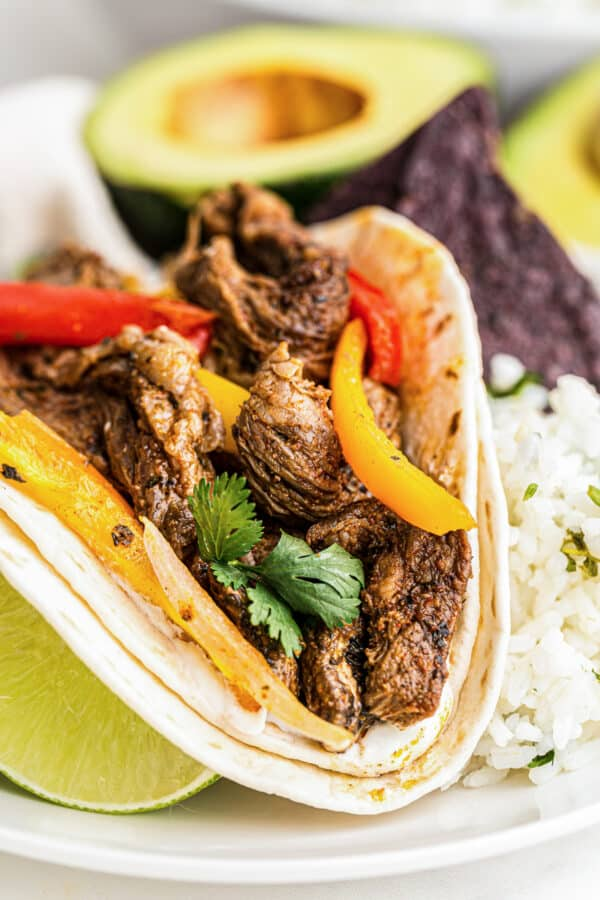 up close image of steak fajitas in tortilla