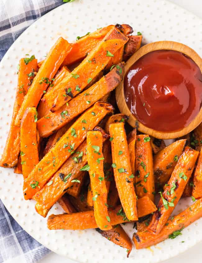 overhead image of sweet potato fries on plate with ketchup