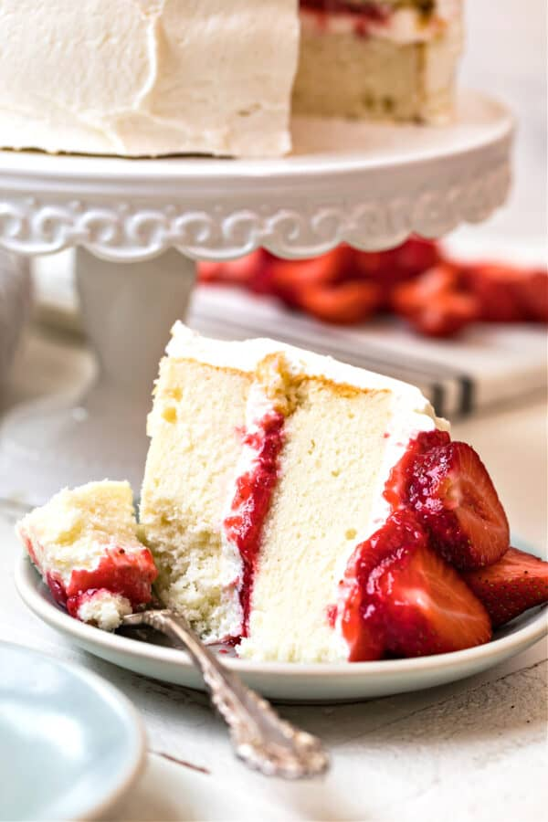slice of white cake with strawberries