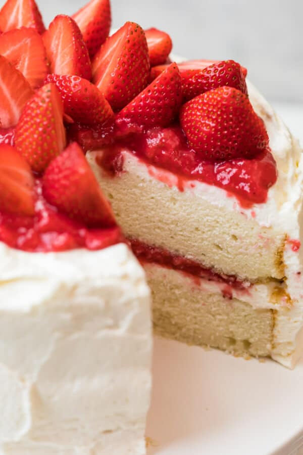 white layer cake with strawberries