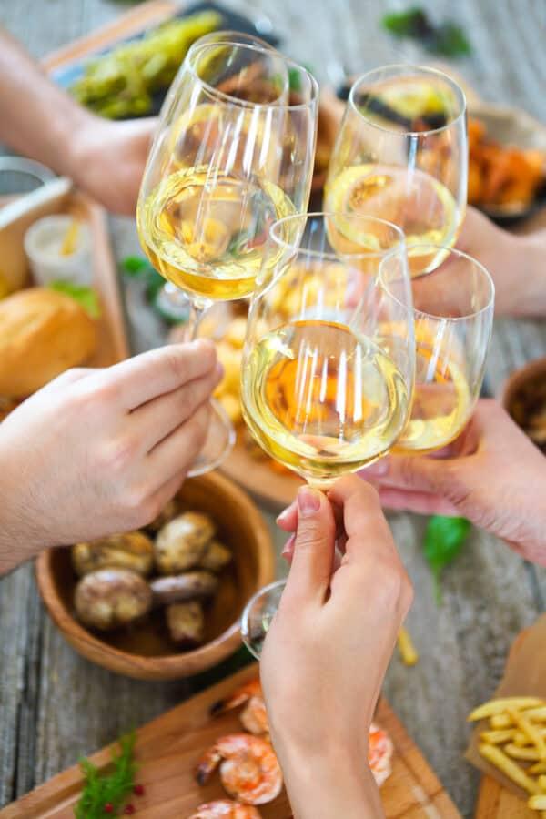 cheersing white wine