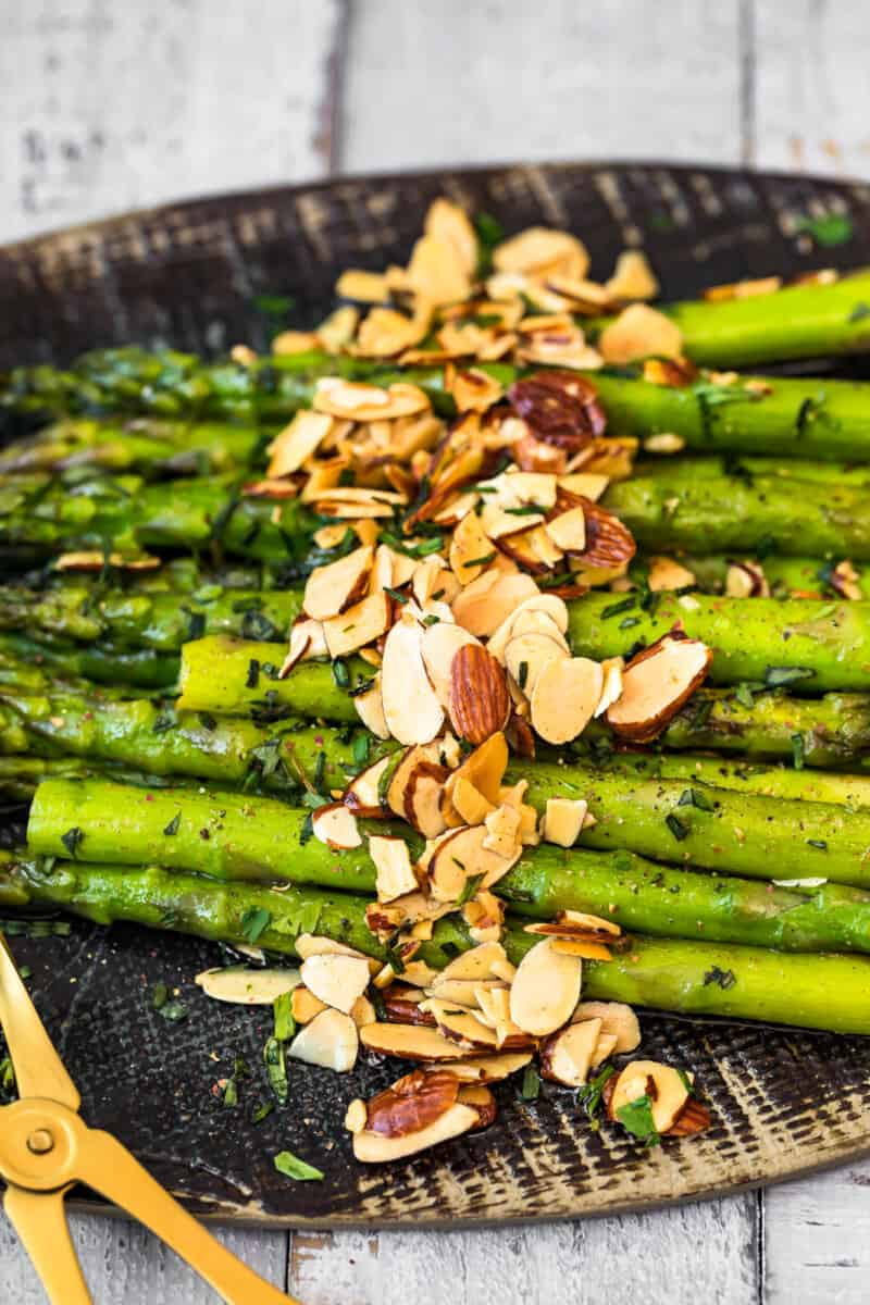 platter with asparagus topped with almonds
