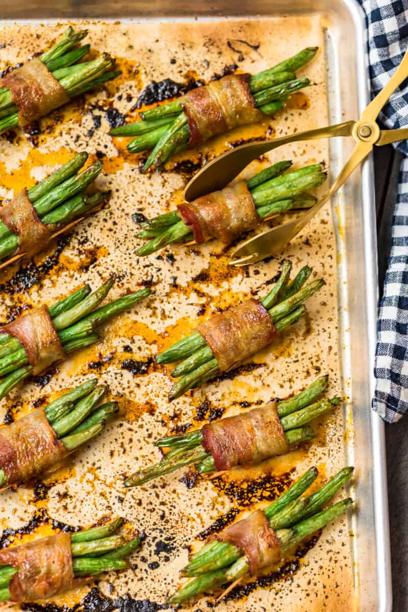 bacon wrapped green bean bundles on baking sheet