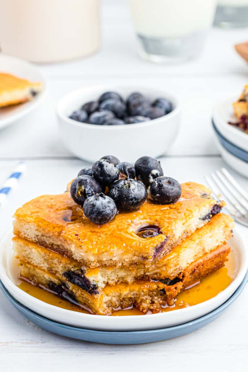 sheet pan blueberry pancakes topped with blueberries