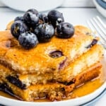 up close image of sheet pan blueberry pancakes with syrup