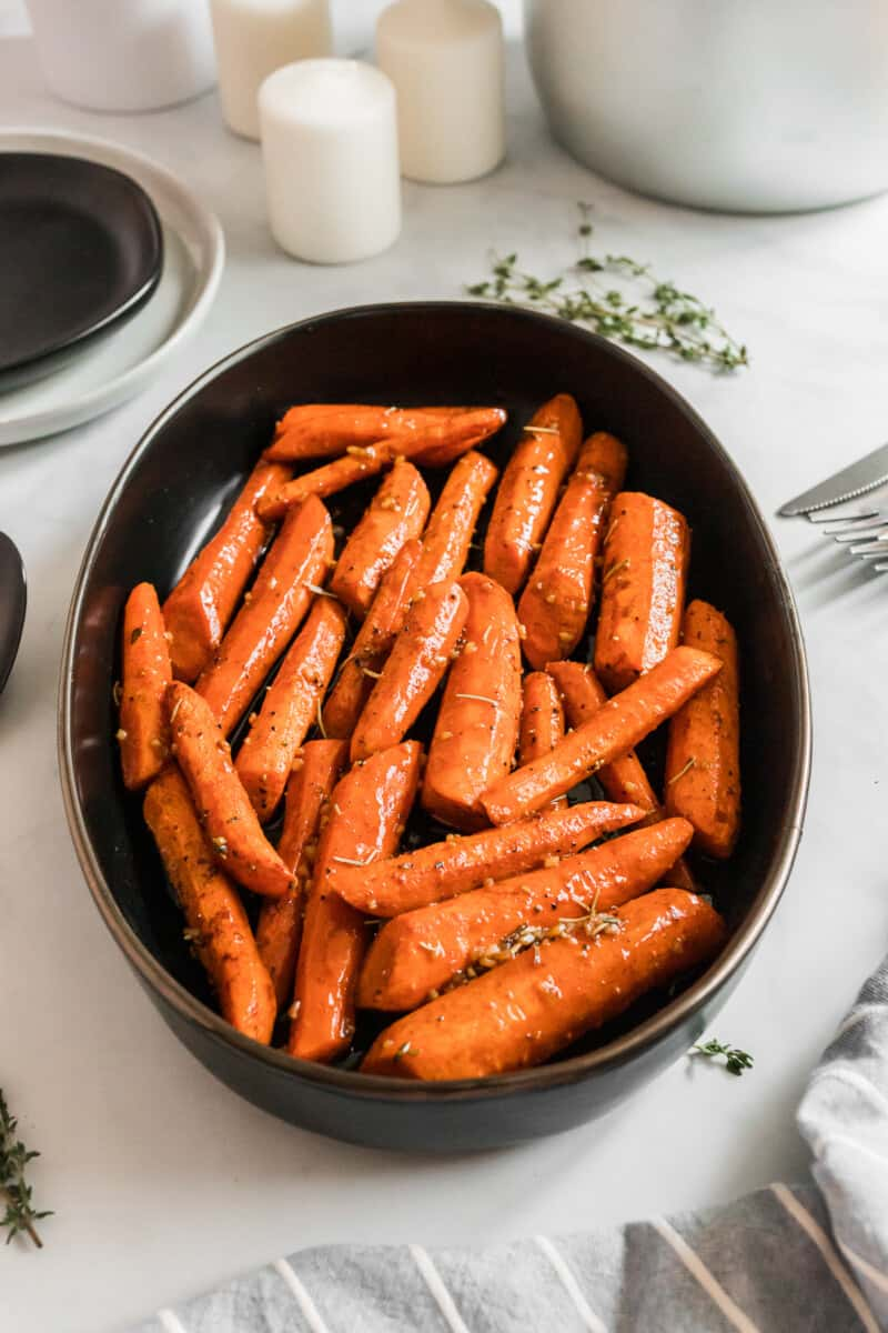 side shot of brown sugar carrots in serving dish
