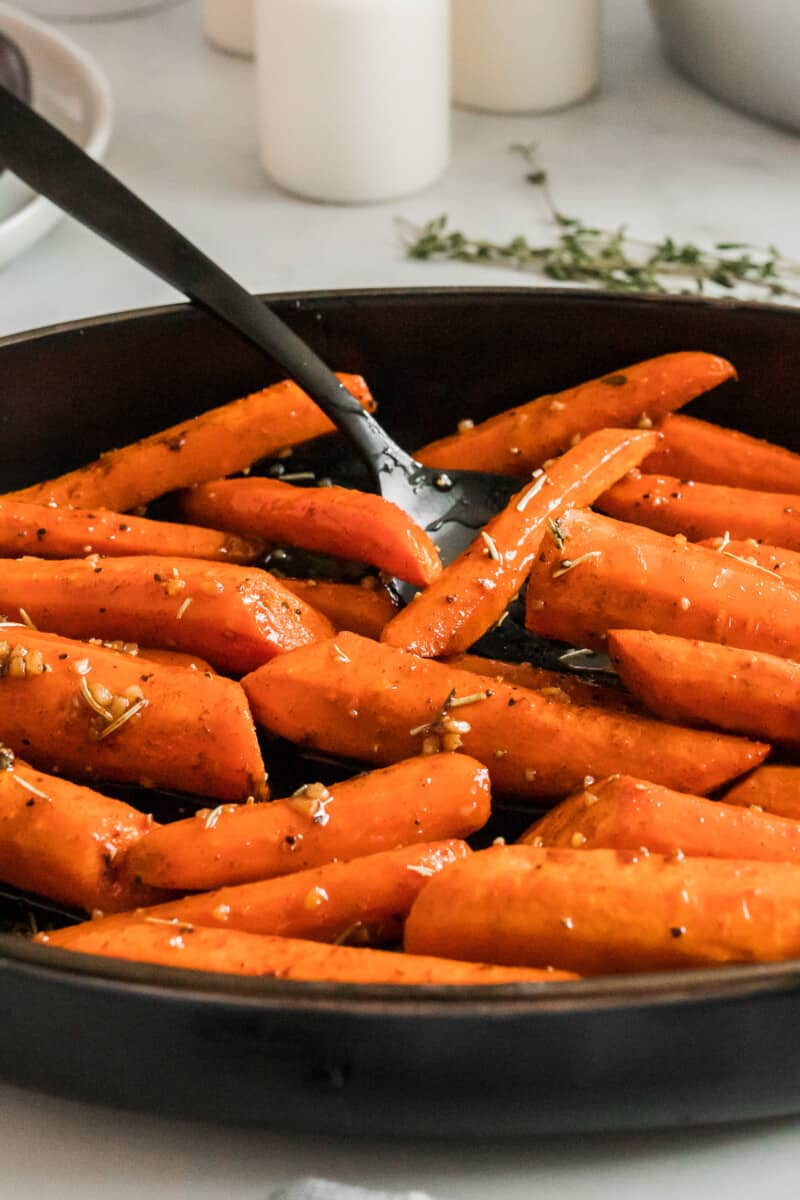 side image of brown sugar carrots with spoon