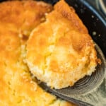 lifting up spoonful of buttermilk spoon bread