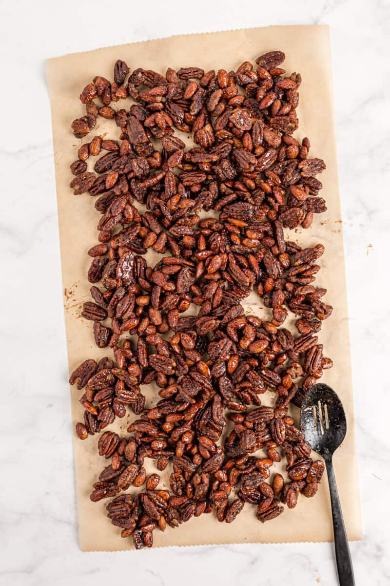 cooling crockpot candied nuts on parchment