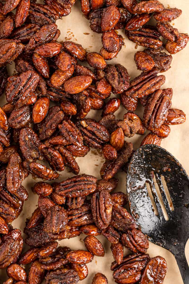 slow cooker spiced candied nuts on parchment