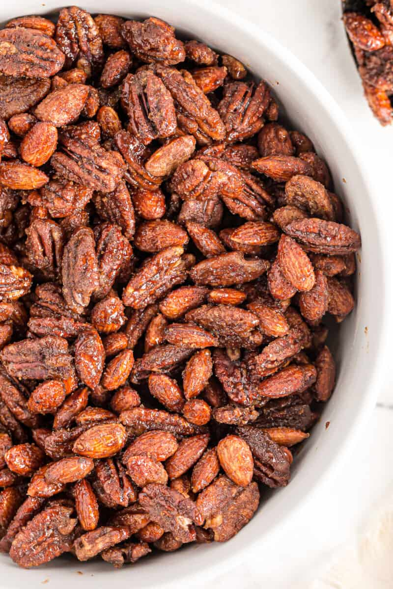 white bowl of candied nuts made in slow cooker