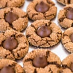 chocolate peanut butter blossoms on baking sheet