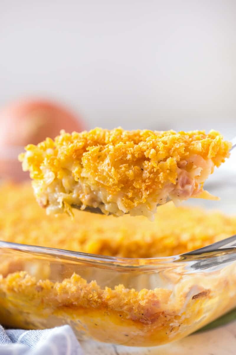 lifting up spoonful of funeral potatoes