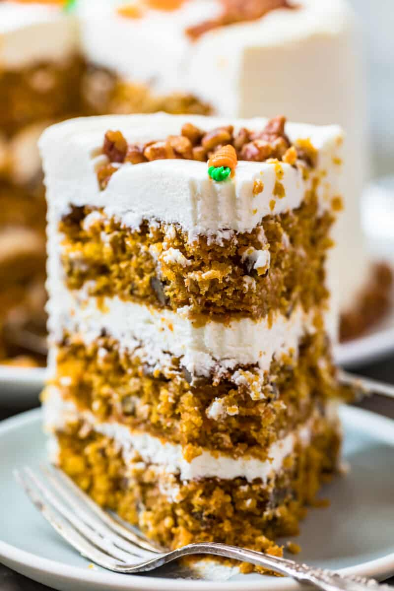 slice of carrot cake standing up on plate