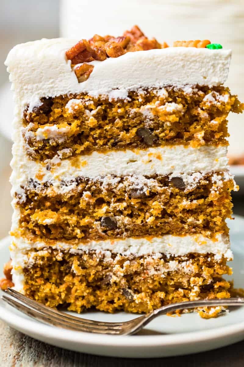 up close slice of carrot cake with three layers
