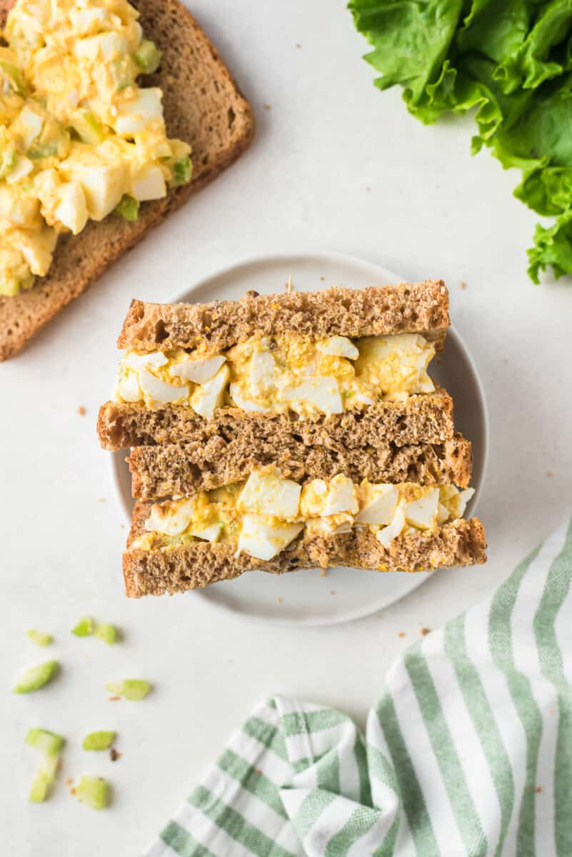 overhead image of egg salad sandwiches on plate