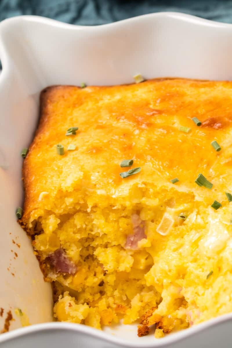 inside of loaded cornbread casserole with cheese and diced ham