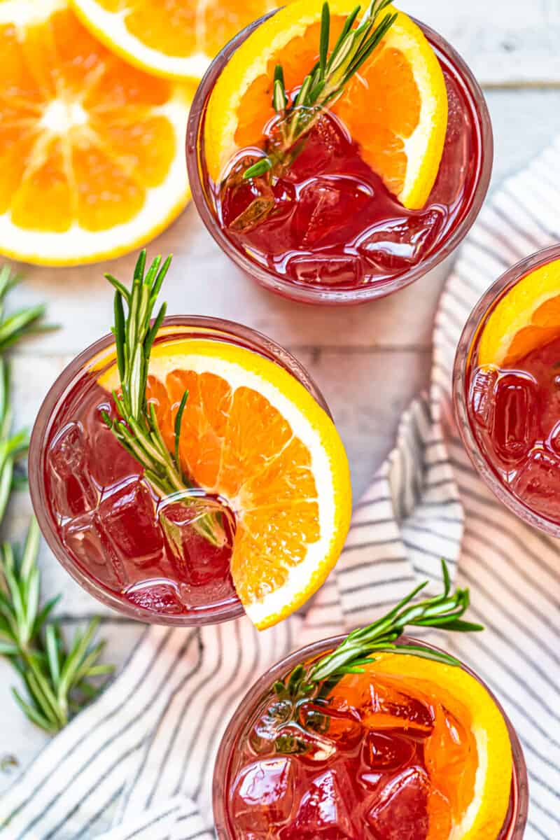 overhead orange cranberry bourbon smash cocktails in glasses