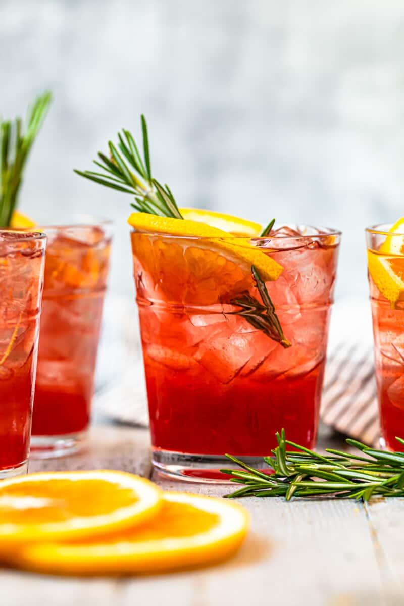 orange cranberry bourbon smash garnished with orange and rosemary