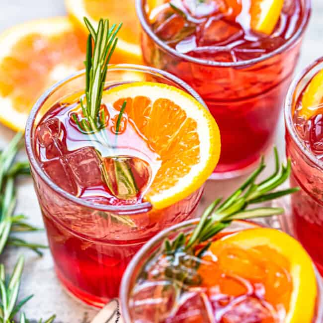 orange cranberry bourbon smash cocktails in glasses