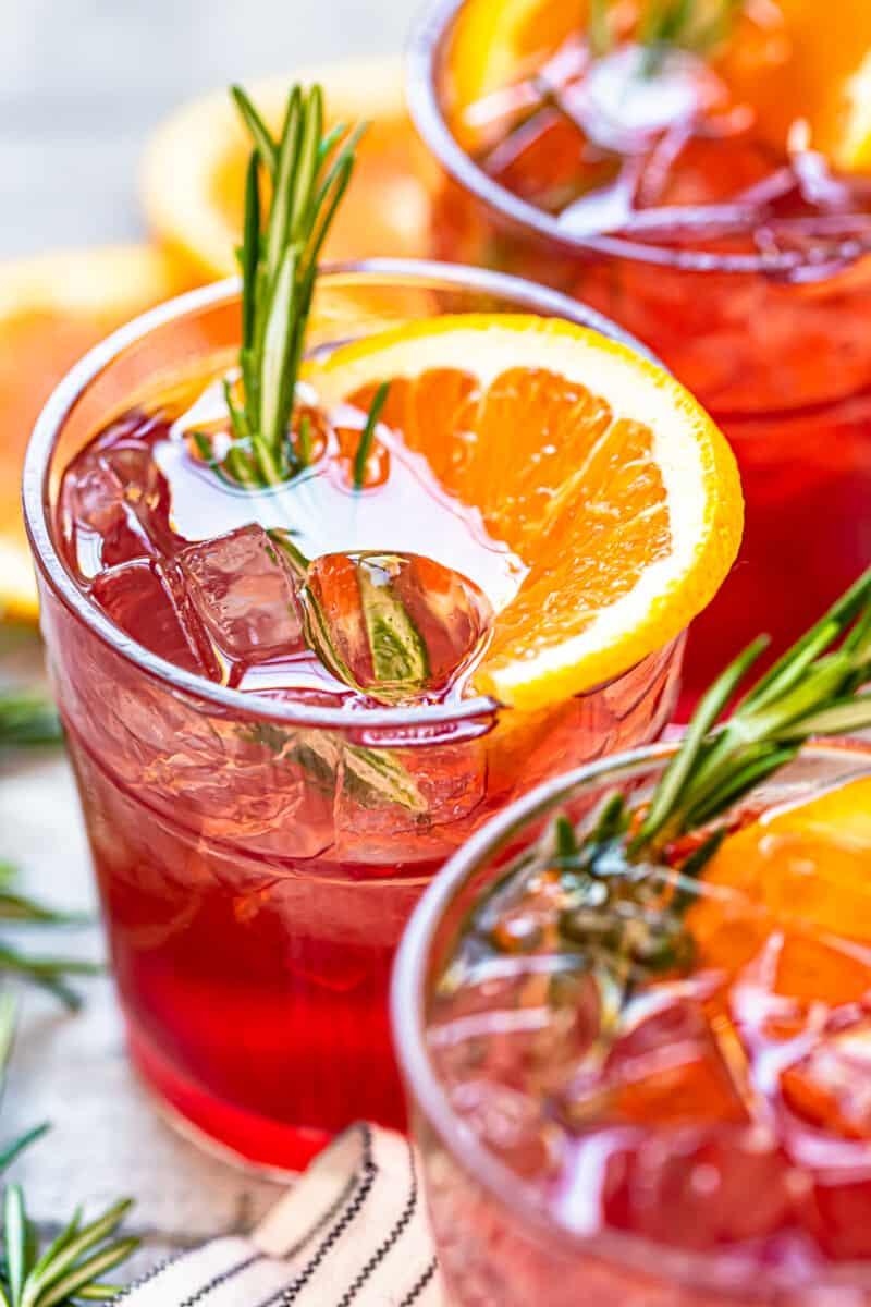 orange cranberry bourbon smash cocktails in glasses