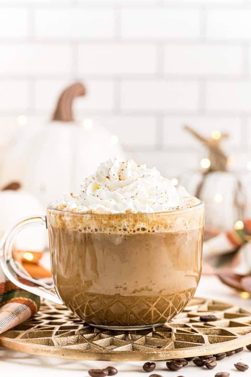 glass mug filled with pumpkin spice latte