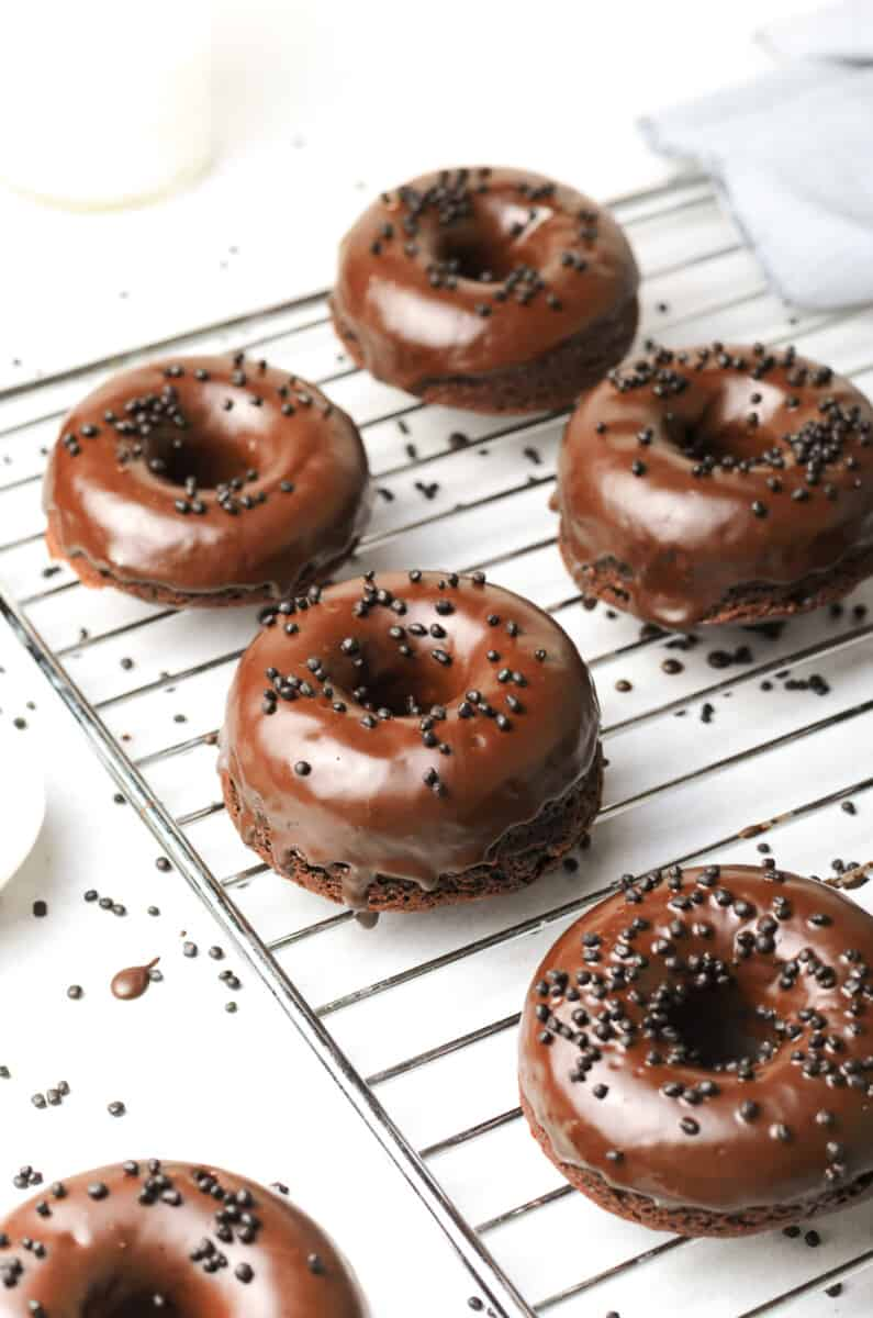 chocolate donuts on cooling rack