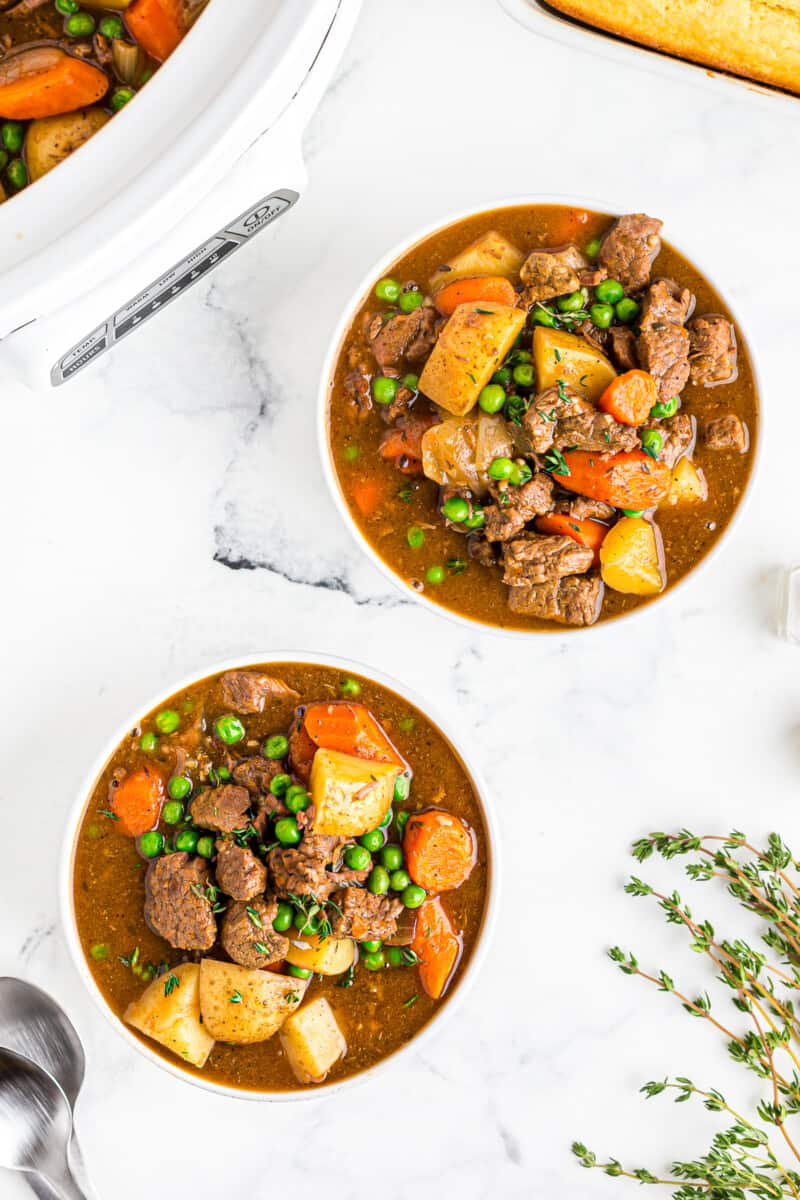 slow cooker beef stew in white bowls