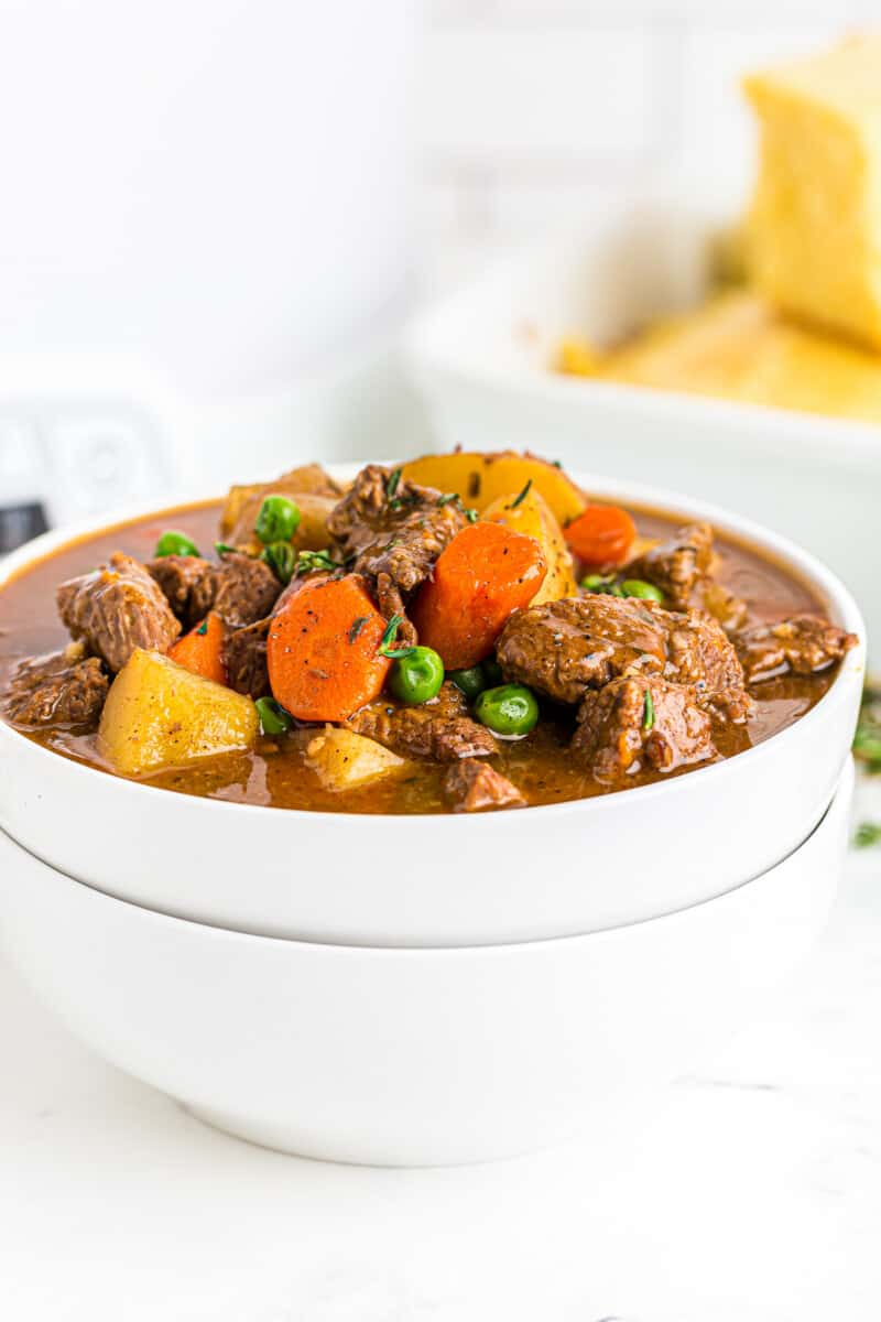 slow cooker beef stew in white bowl