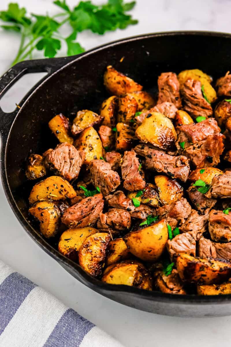 garlic steak and potatoes in skillet