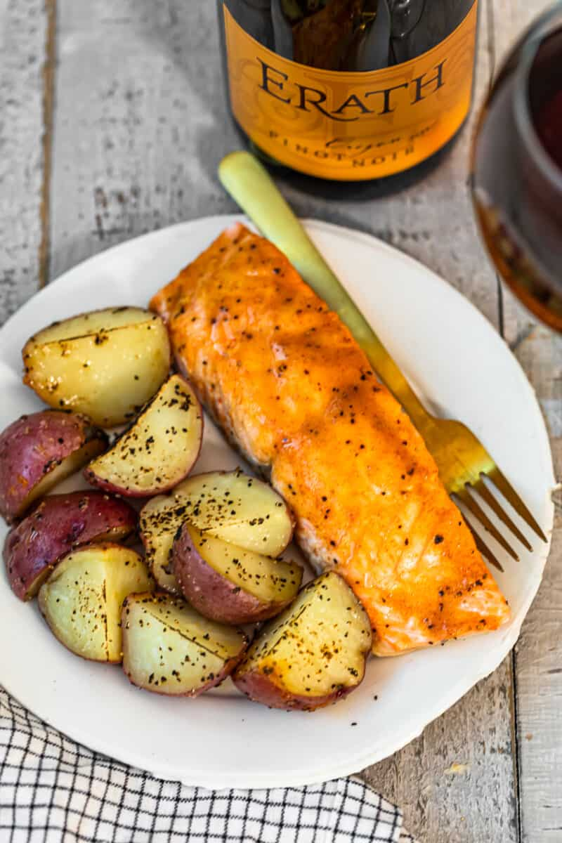 maple salmon and potatoes on white plate