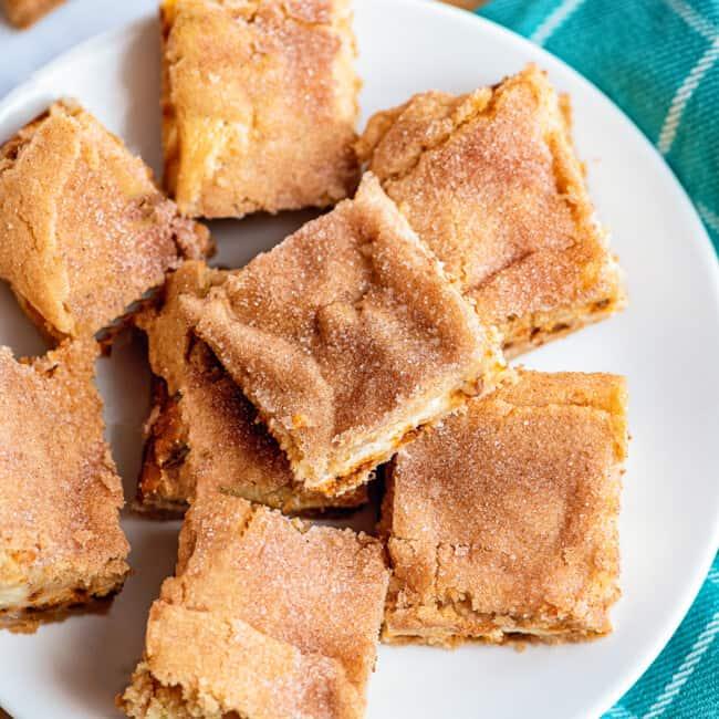 sugar cookie cheesecake bars on plate
