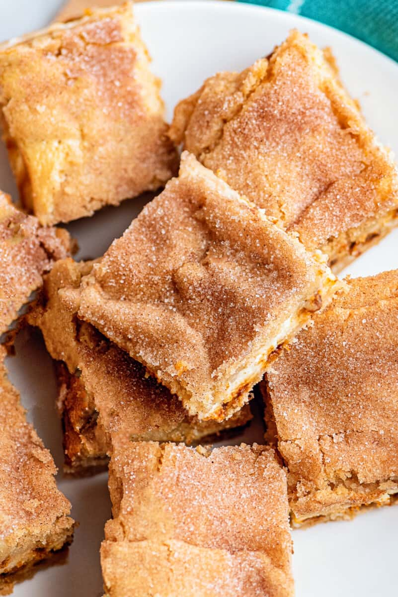 snickerdoodle cheesecake bars cut on plate
