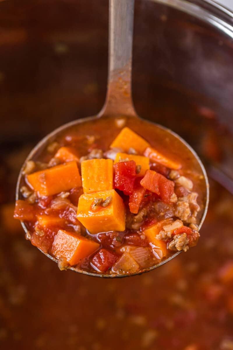 ladle with sweet potato chili