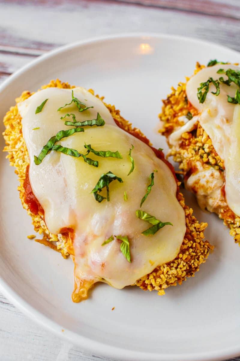 white plate with air fryer stuffed chicken parmesan