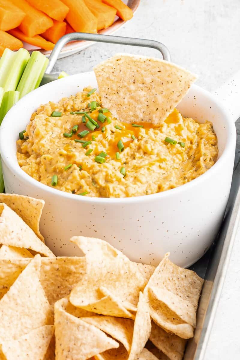 Vegan buffalo chicken dip with chips.