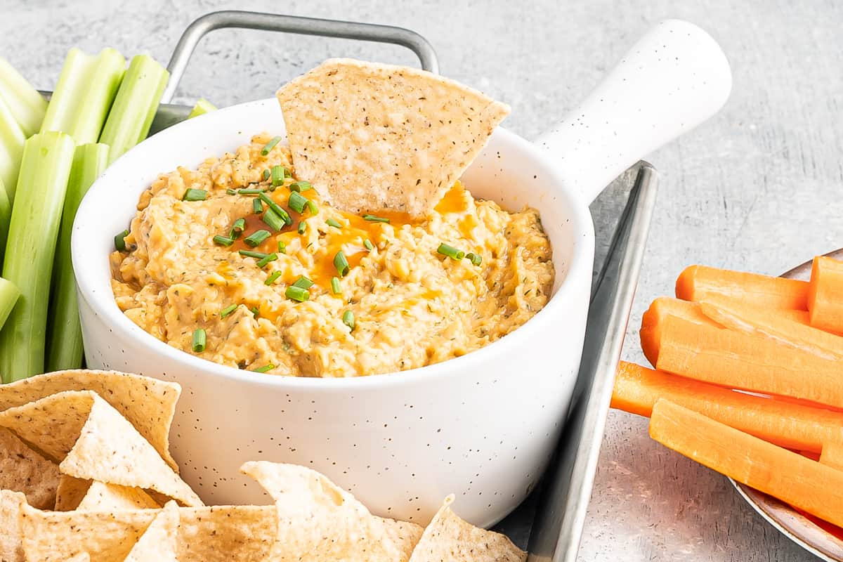 buffalo chickepea dip in white bowl