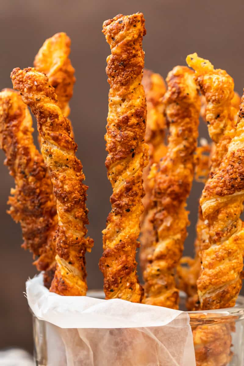 cheese straws stacked in glass