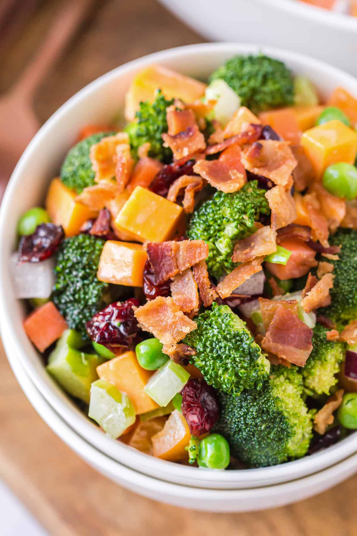cheesy broccoli salad with bacon in bowl