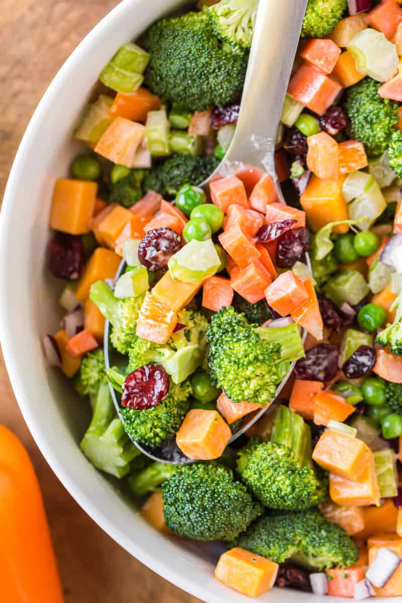bowl with broccoli salad and wooden spoon