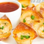 baked crab rangoon bites next to dipping sauce