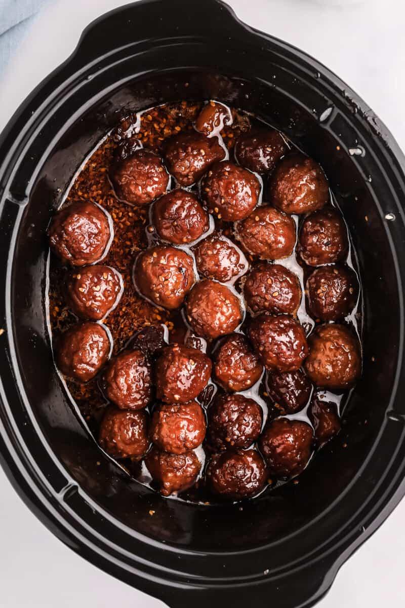 Crockpot of teriyaki meatballs.