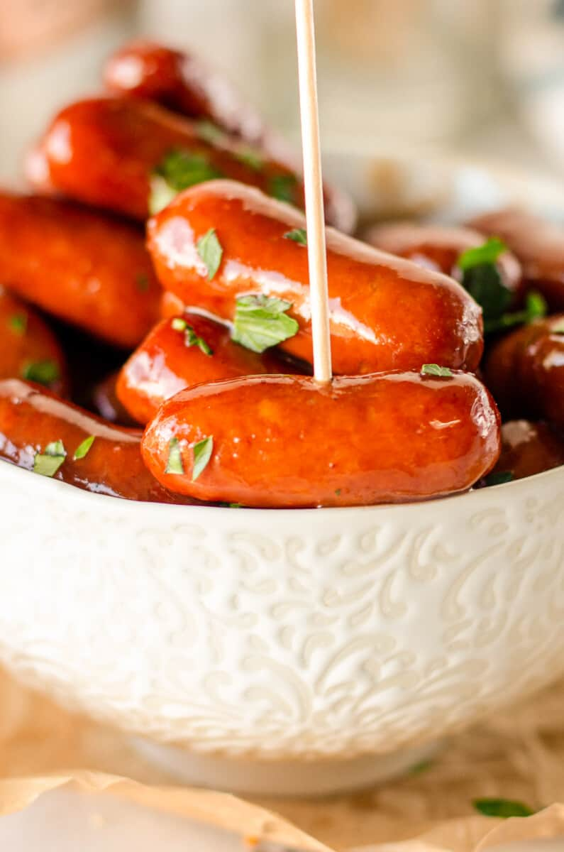Sausages in white bowl.