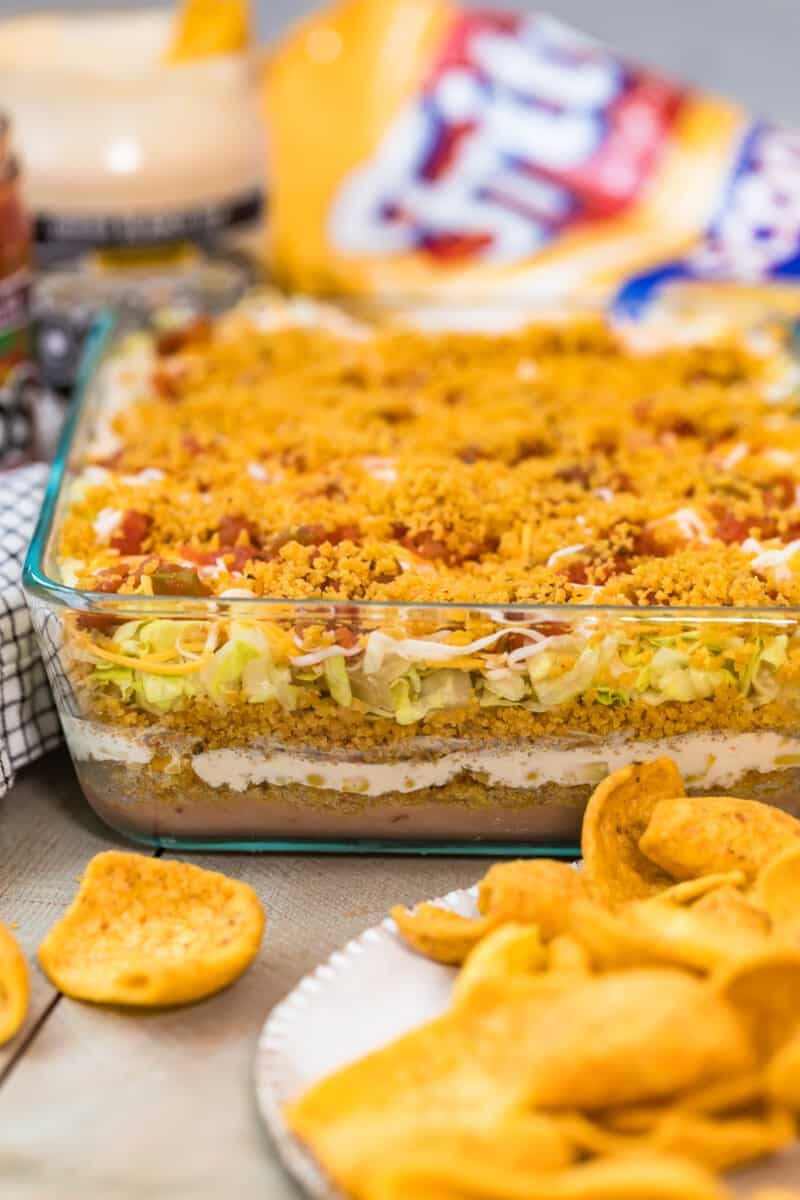 Fritos mexican layer dip in casserole dish.