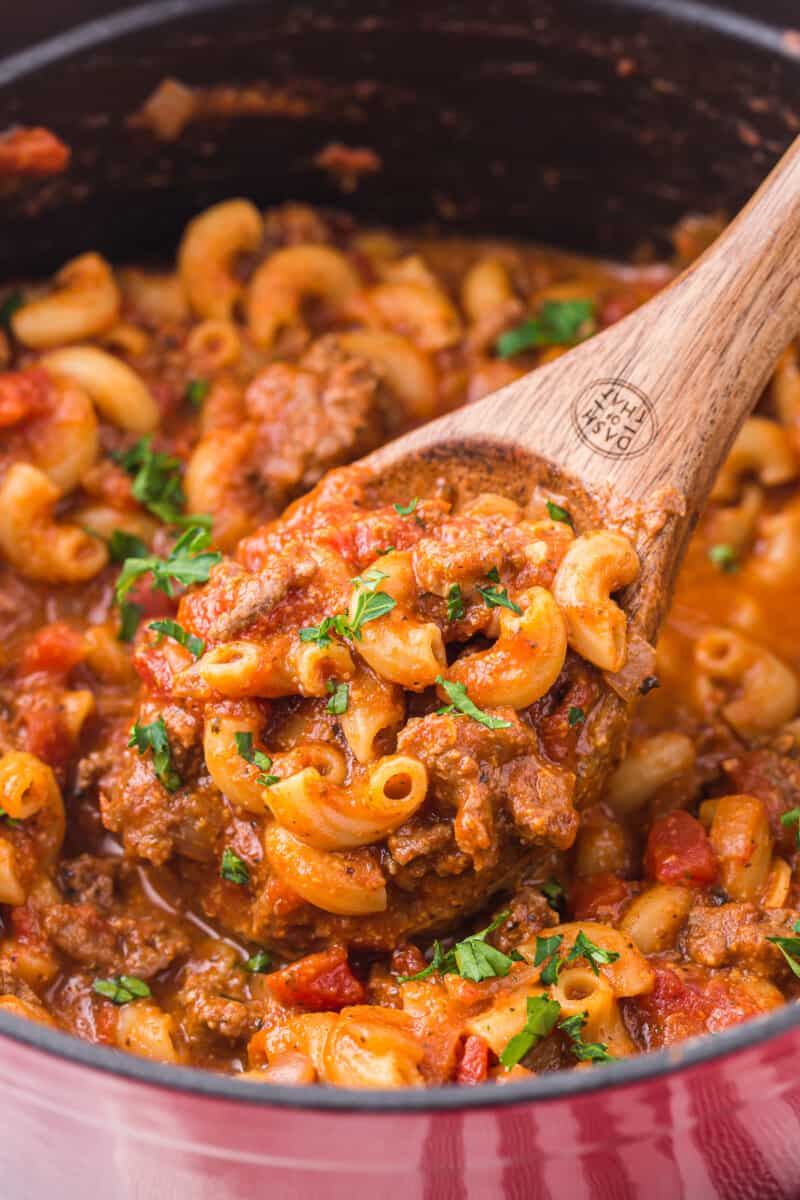 wooden spoon lifting up goulash