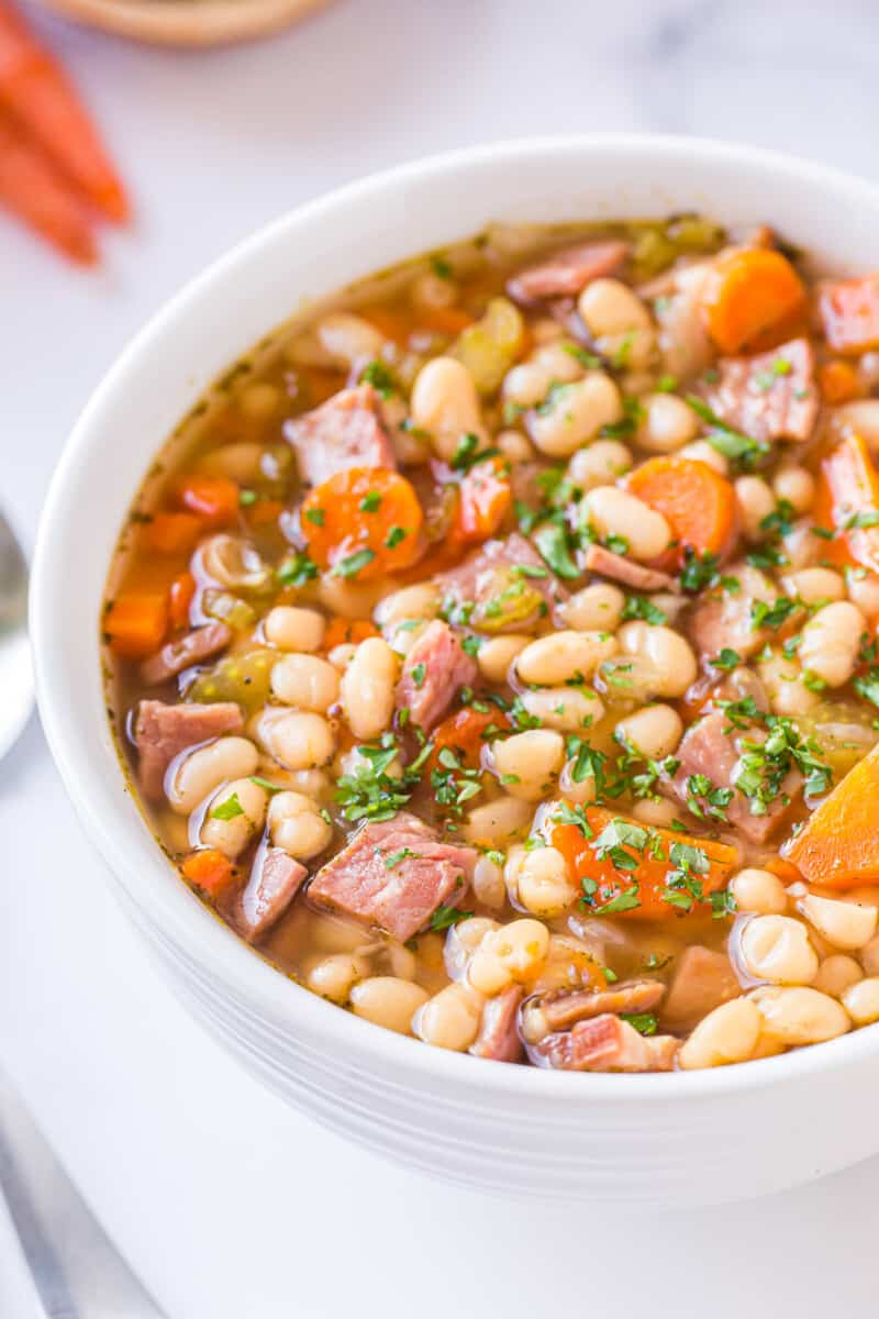 instant pot ham and bean soup in white bowl