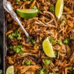 instant pot carnitas garnished with cilantro and lime