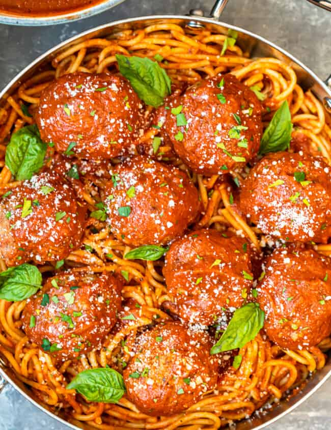 meatballs over pasta in pan