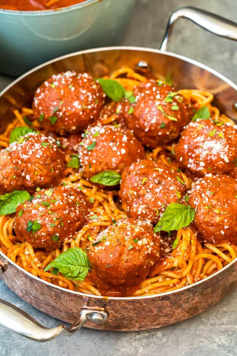 meatballs over pasta in pan