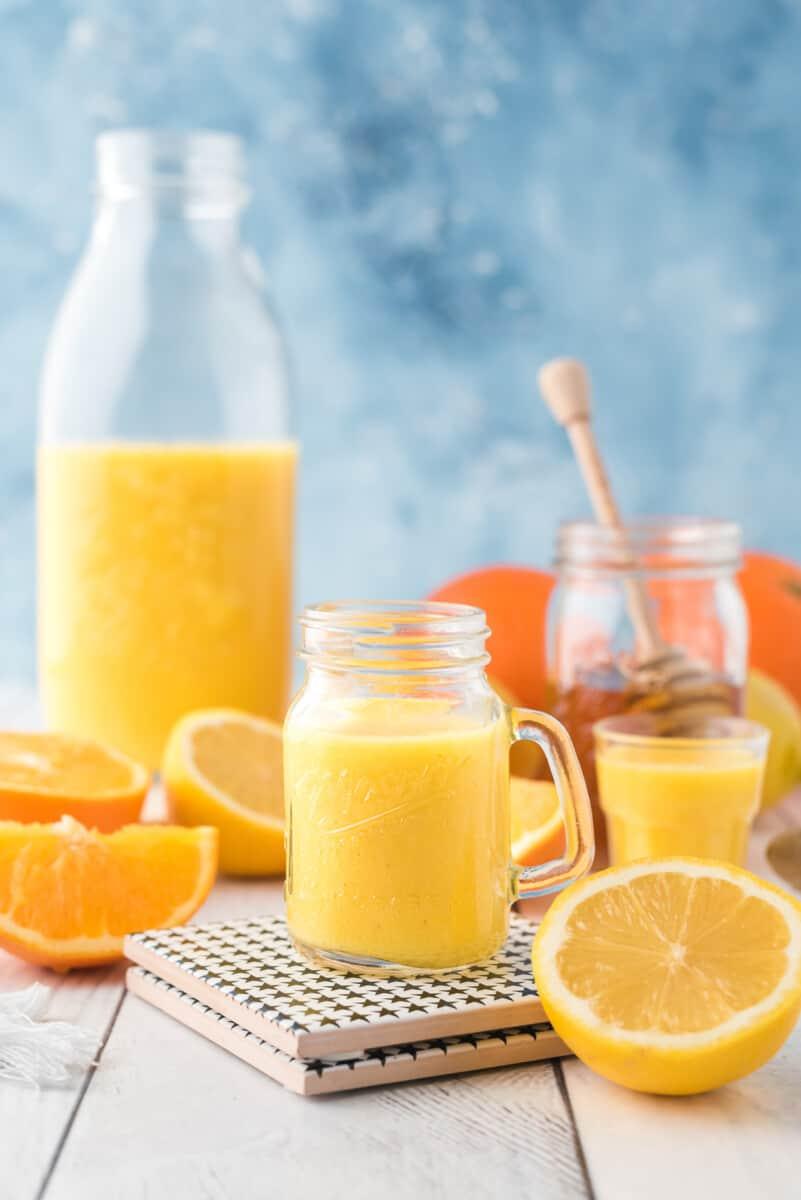 orange ginger shot on table